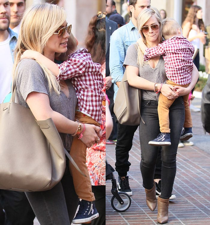 Hilary Duff ina gray V-neck tee tucked into a pair of dark skinny jeans
