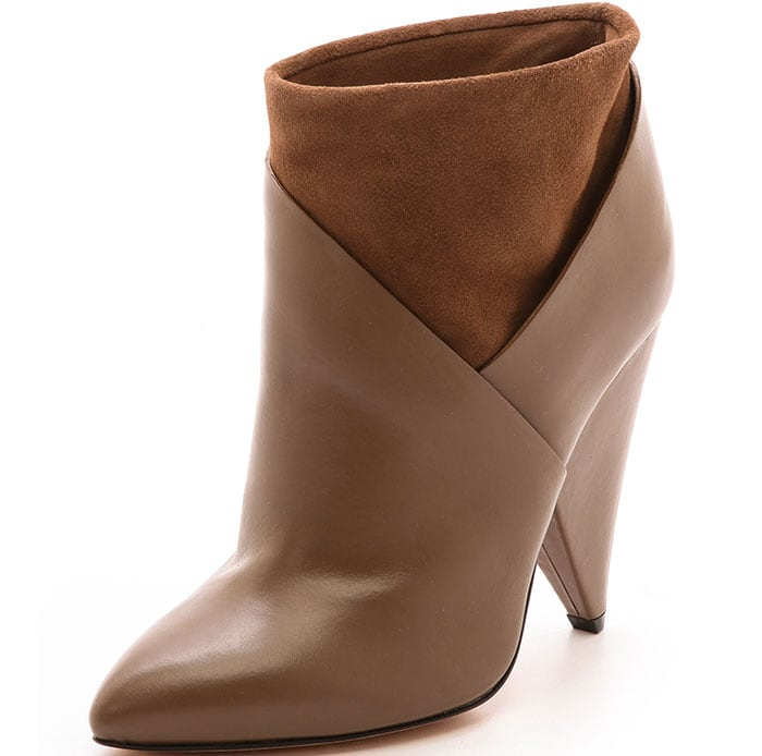 The toe tapers to a structured point, and a wide cone heel elevates the silhouette