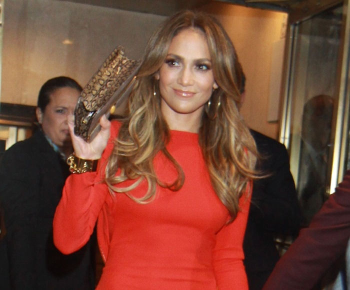 Jennifer Lopez styled her red pumps with a matching form-fitting Tom Ford dress featuring a gold shoulder-to-hip zipper detail