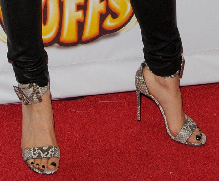 Jessie J shows off her feet in snakeskin sandals
