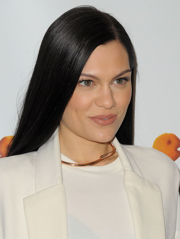 Jessie J's slick raven locks were styled straight and parted to the side