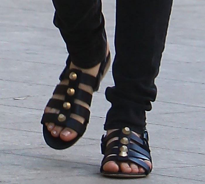 Kaley Cuoco shows off her feet in flat Balenciaga leather sandals