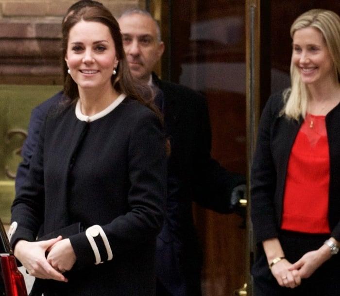 Catherine, Duchess of Cambridge (aka Kate Middleton) toting a clutch by Stuart Weitzman