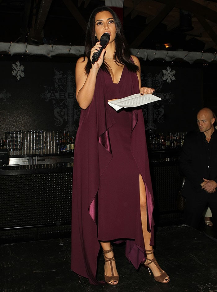 Kim Kardashian wears her hair down at Elizabeth Taylor Foundation/World AIDS Day