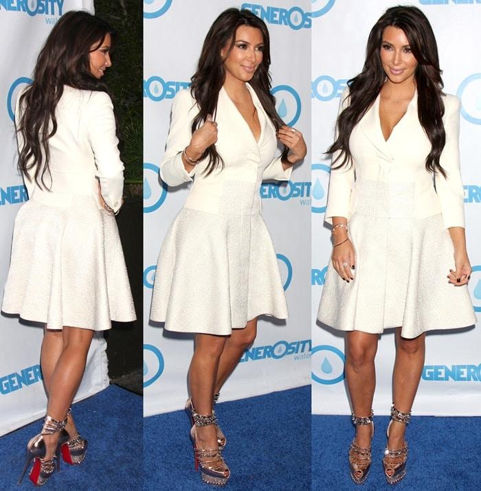 Kim Kardashian ina demure creamy white dress