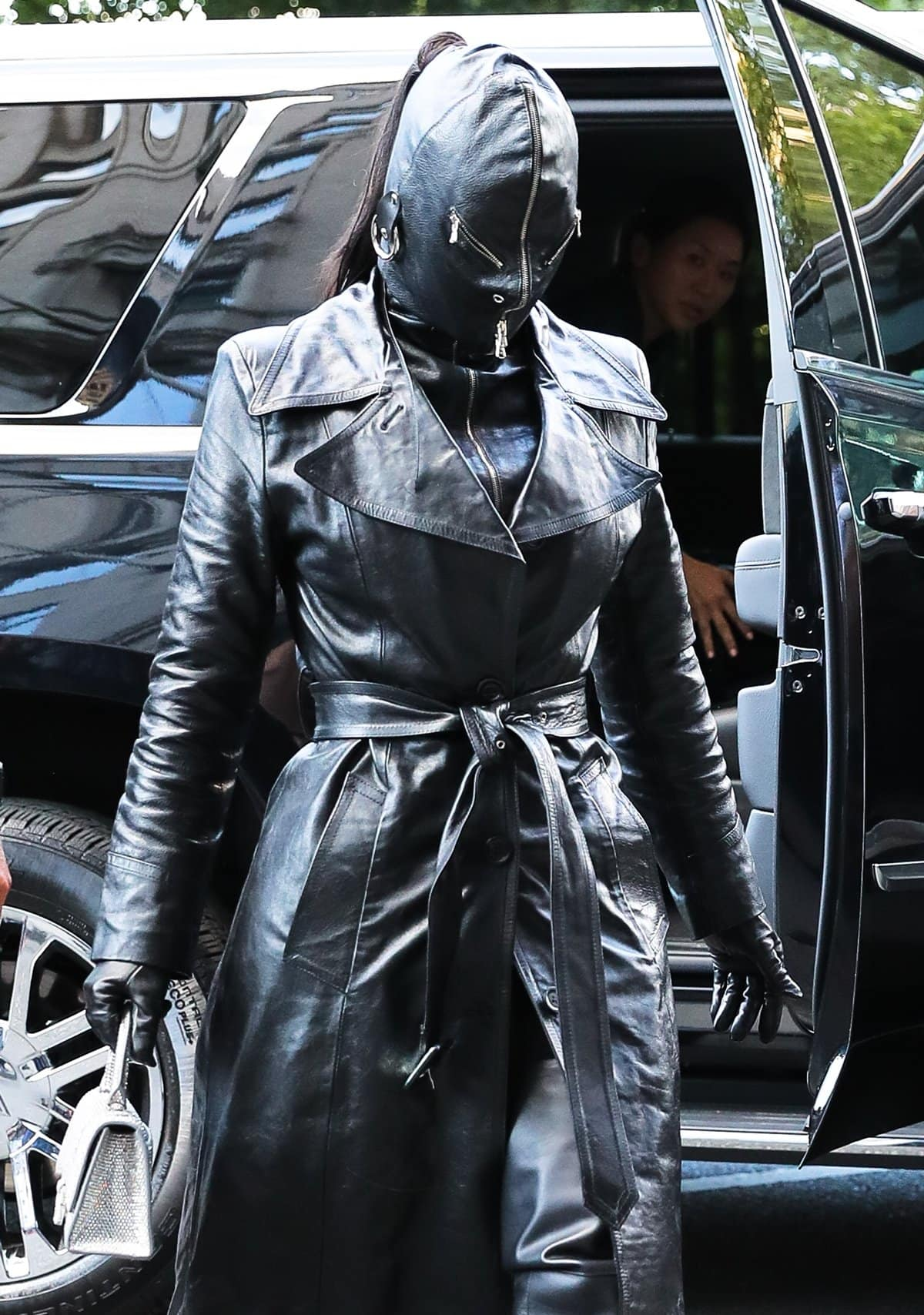 Kim Kardashian covered head to toe with a leather suit