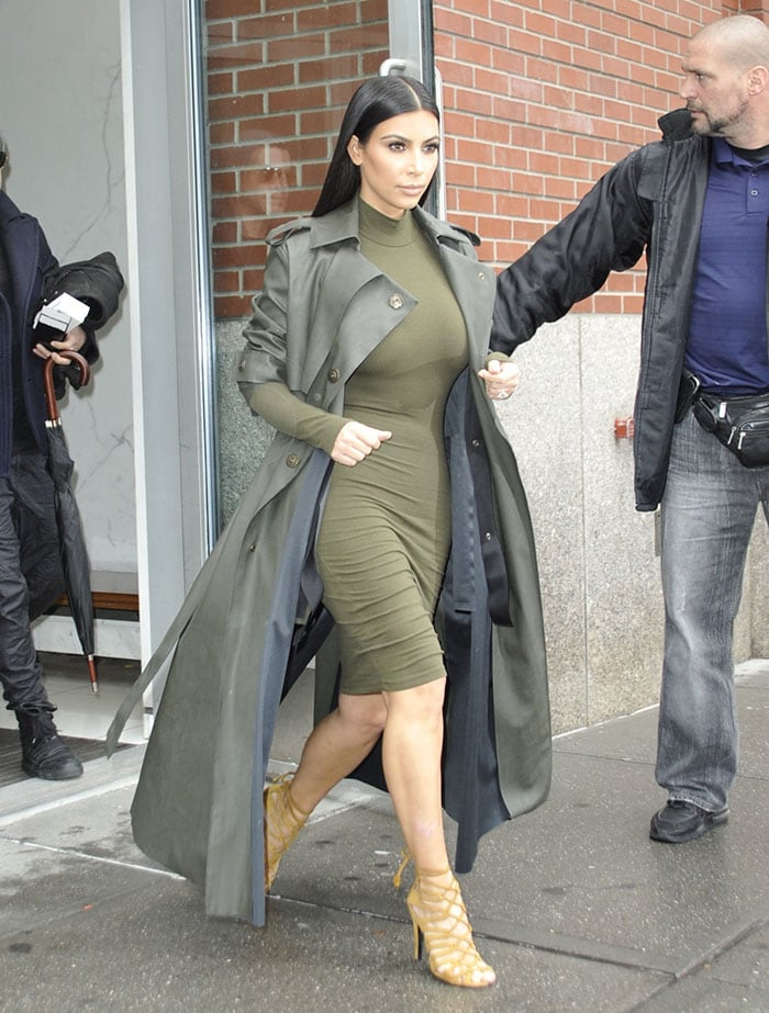 Kim Kardashian wears her hair down as she leaves her New York City apartment