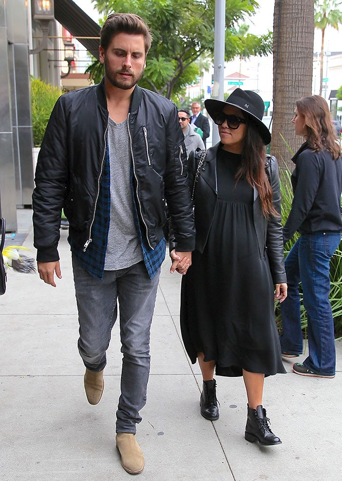 Kourtney Kardashian styled her all-black outfit with a hat and boots