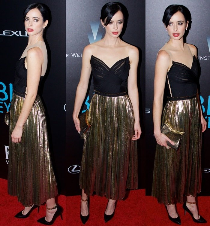 Krysten Ritter ina black-and-gold pleated dress by J. Mendel