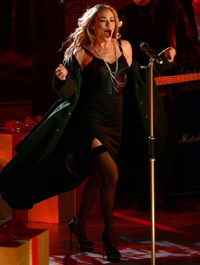 LeAnn Rimes flaunted her sexy curves in a black bustier and a fitted knee-length skirt