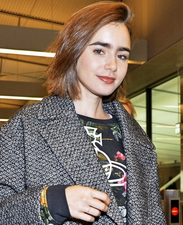 Lily Collins arriving at Narita International Airport in Chiba, Japan, on December 1, 2014