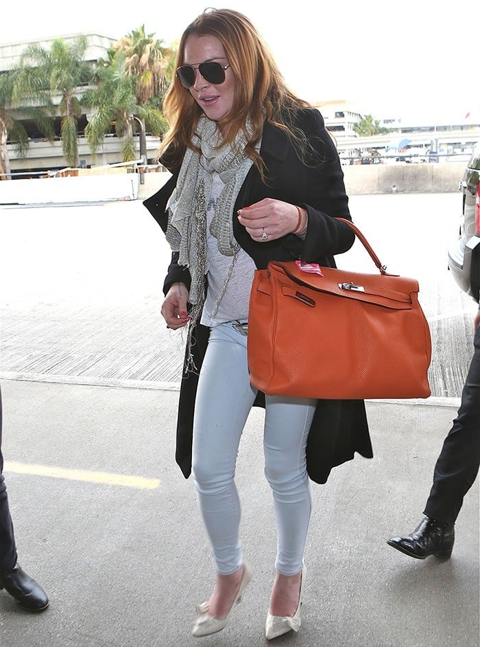 Lindsay Lohan returns to Los Angeles after recovering from Chikungunya on December 30, 2014