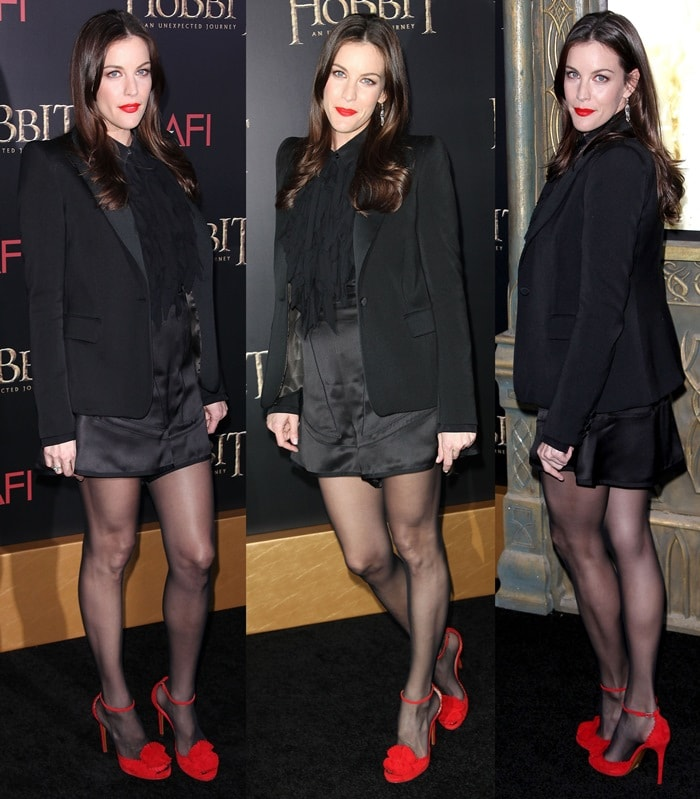 Liv Tyler in a tuxedo blazer worn over a Givenchy ruffled silk blouse and satin skirt