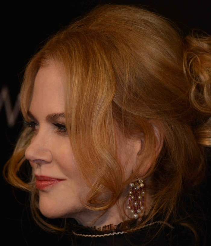 Nicole Kidman shows off her statement earrings and unpopular hairdo