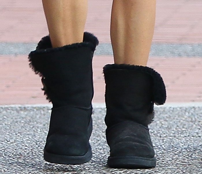 Nikki Reed wears black UGG Bailey Button boots