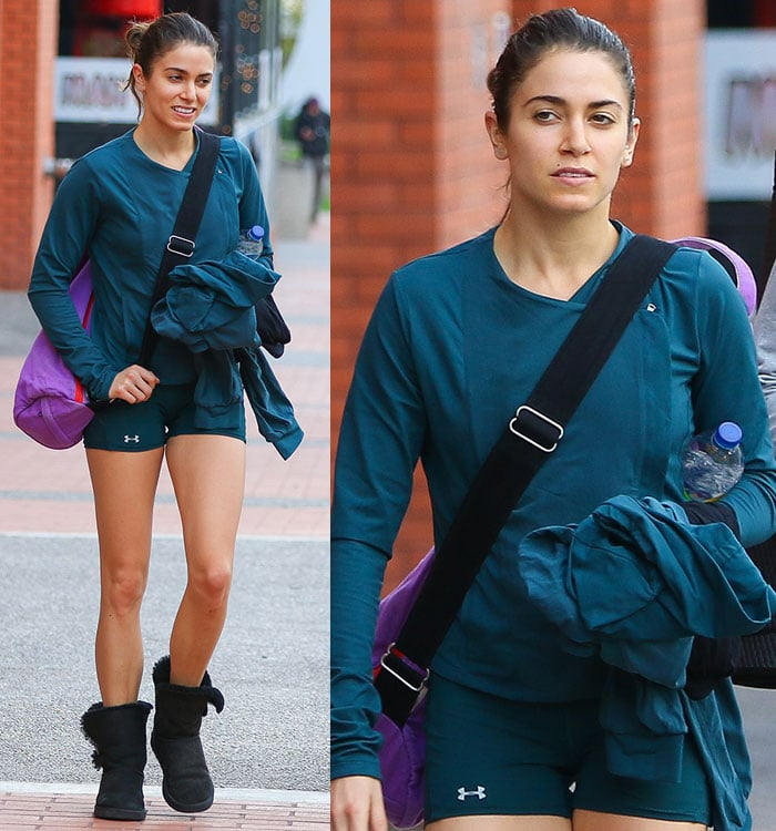 Nikki Reed wearing black uggs with a green jacket and matching tight shorts