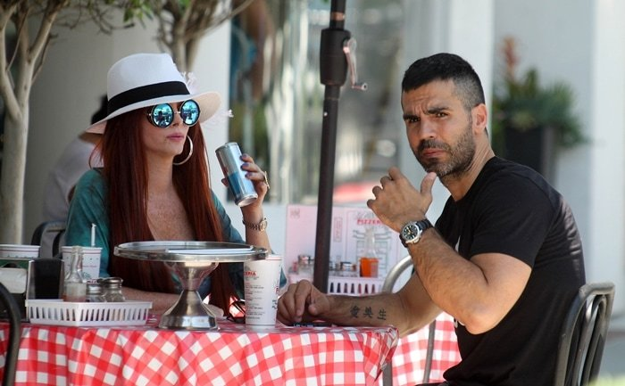 Phoebe Price has lunch at Mulberry Street Pizza with her on-again-off-again boyfriend Ojani Noa, Jennifer Lopez's first husband