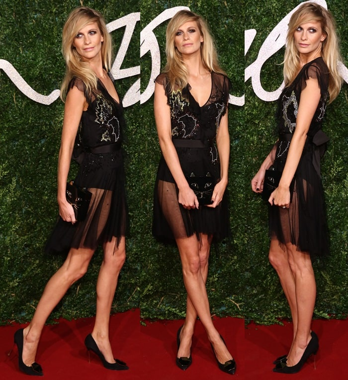 Poppy Angela Delevingne flaunts her incredible legs ina black embellished dress from Topshop featuring mesh panels near the hem