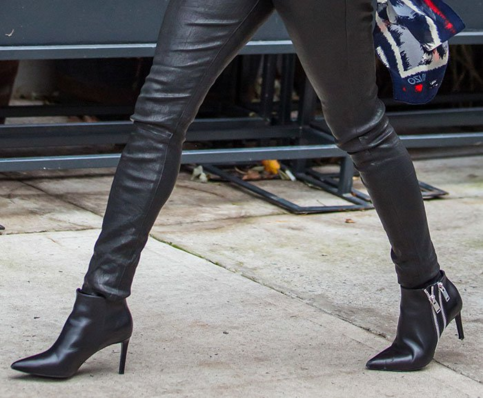 Reese Witherspoon wearing Saint Laurent ankle boots