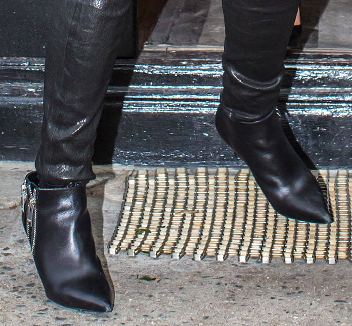 Reese Witherspoon paired her black leather pants with matching ankle boots