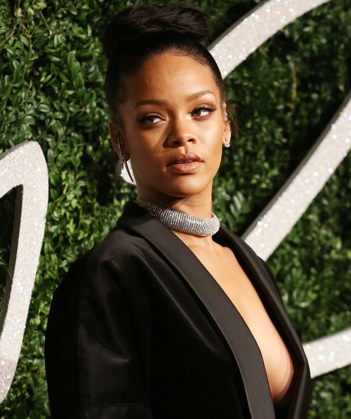 Rihanna flashing her cleavage while wearing just a blazer on the red carpet at the 2014 British Fashion Awards held at London Coliseum in London, England, on December 1, 2014