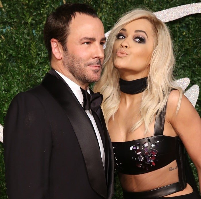 Rita Ora and Tom Ford on the red carpet at the 2014 British Fashion Awards held at London Coliseum in London, England, on December 1, 2014