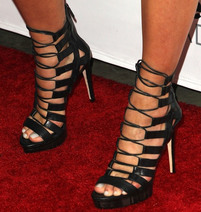 Rita Ora shows off her hot feet in strappy black heels