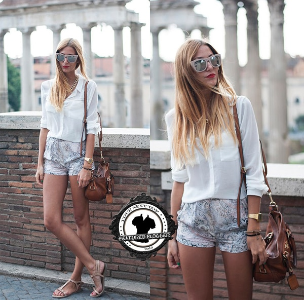 Andrea flaunts her legs in paisley-printed shorts
