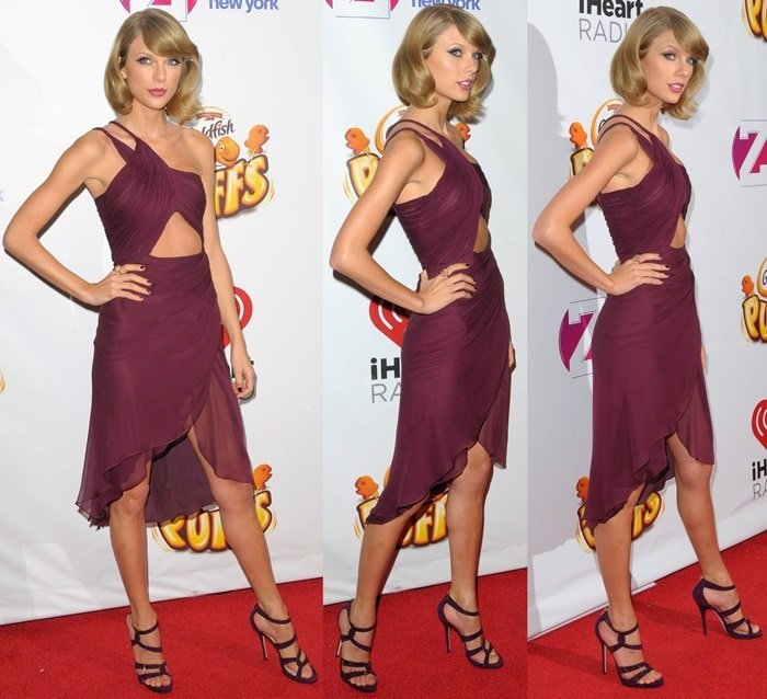 Taylor Swift flaunts her abs in a layered asymmetric dress