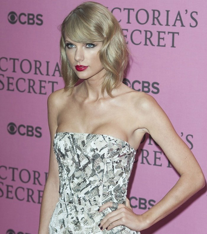Taylor Swift sparked boob job rumors in a sexy little dress at the 2014 Victoria's Secret Fashion Show