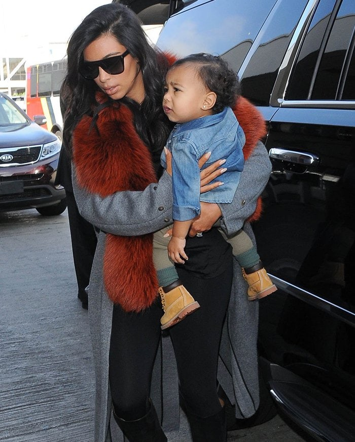 Kim Kardashian and North West (in Timberland toddler boots) at LAX on September 22, 2014