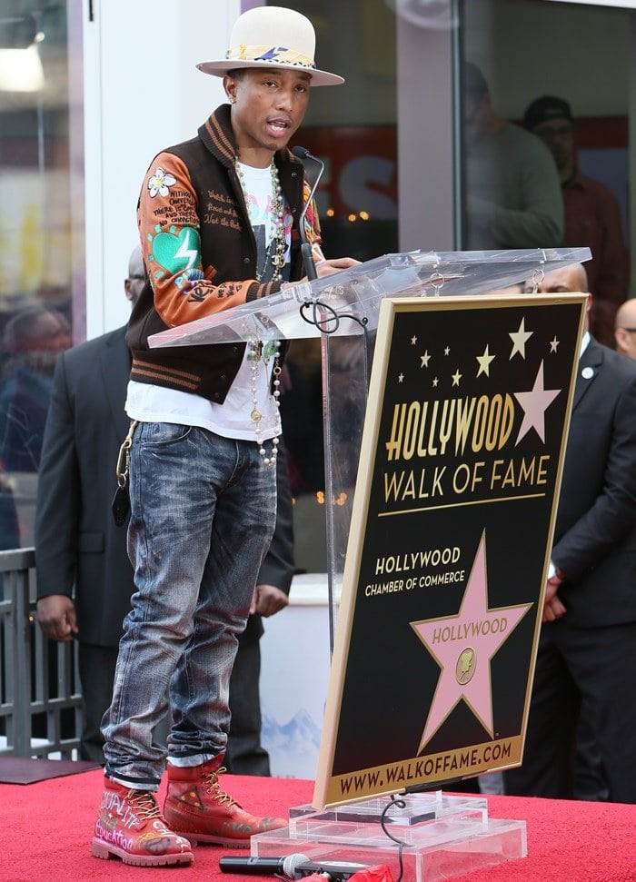 Pharrell Williams receiving a star on the Hollywood Walk of Fame in Los Angeles on December 4, 2014