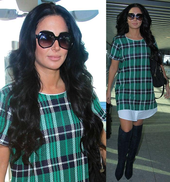Tulisa Contostavlos wearing a tartan dress at an airport
