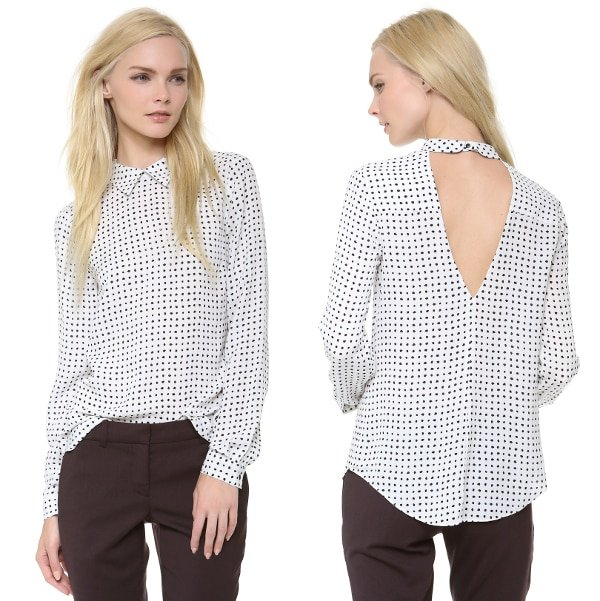 A polka-dot silk A.L.C. blouse blends allure with preppy chic, pairing a crisp fold-over collar with a deep V back