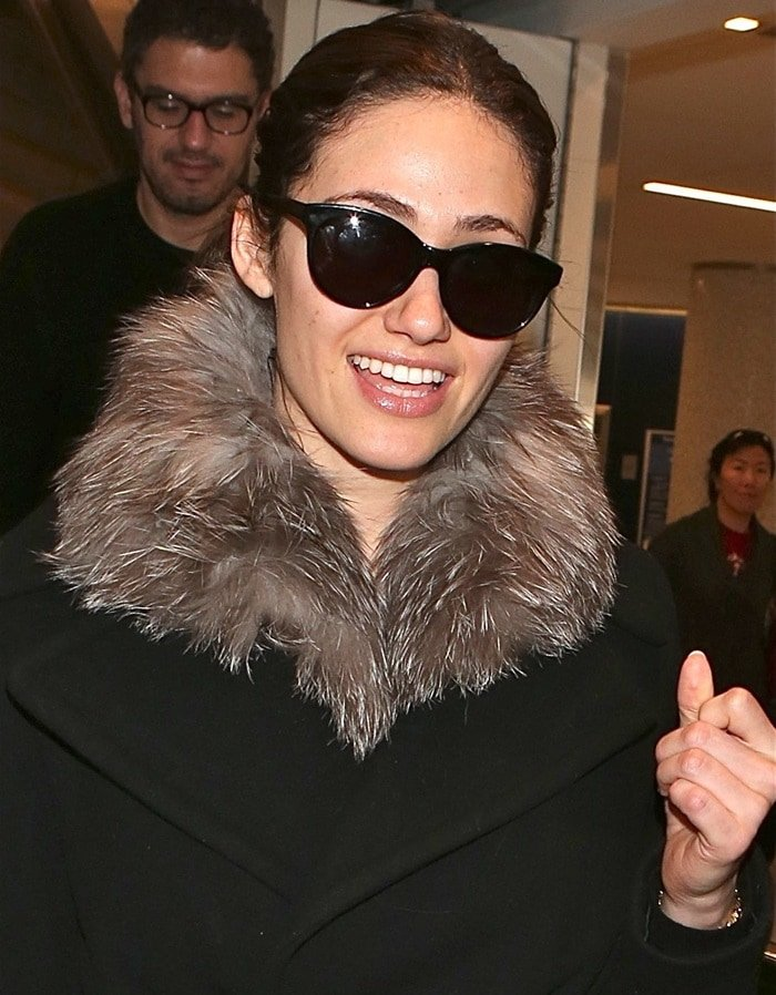 Emmy Rossum arriving at the Los Angeles International Airport on December 28, 2014