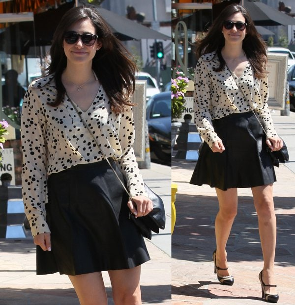 Emmy Rossum leaving a dry bar in Los Angeles, wearing a speckled white blouse on August 23, 2013