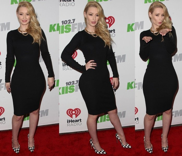 Iggy Azaleaflaunts her sexy legs in a figure-hugging black ribbed dress