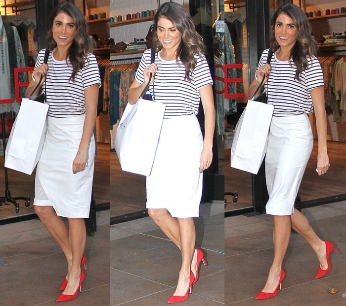 Nikki Reed flaunts her legs ina striped T-shirt and a white pencil skirt