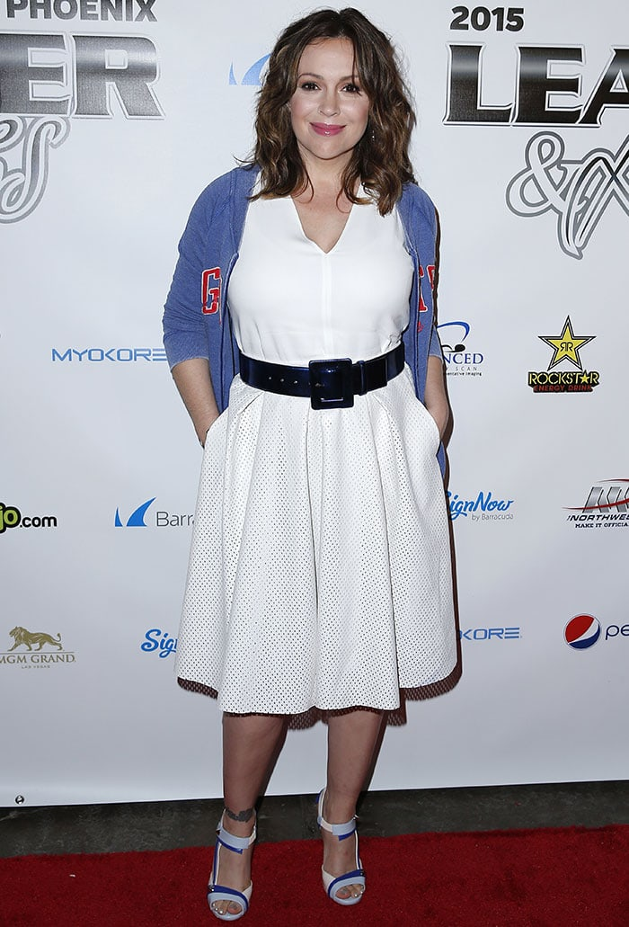 Alyssa Milano flaunted her legs in a white dress with a perforated skirt and a blue jacket