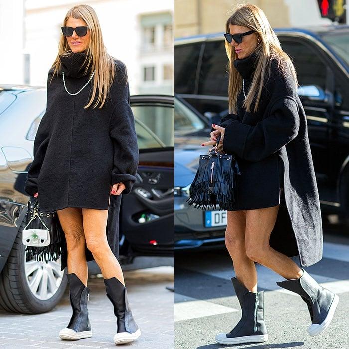 Anna Dello Russo wearing tall sneaker boots