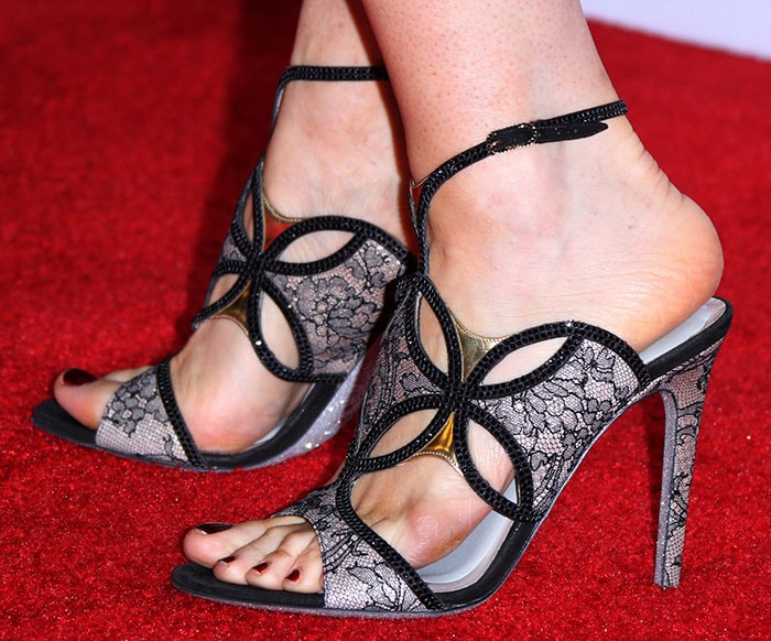 Bellamy Young wearing Rene Caovilla's lace-covered stiletto heels
