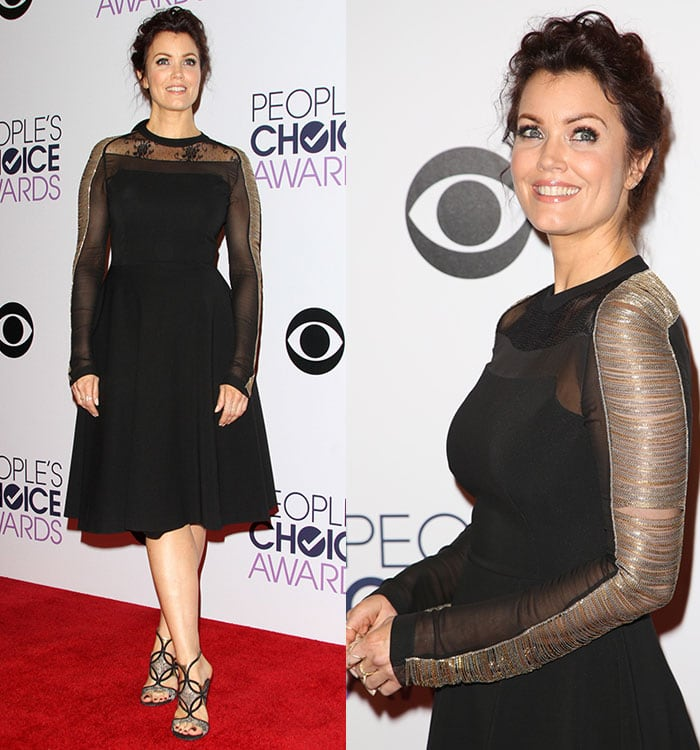 Bellamy Young ina black Alberta Ferretti dress featuring a lace insert at the neck and sheer long sleeves embellished with metallic gold and silver chains