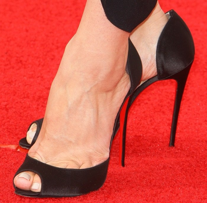 Jessica Pare's sexy feet and toe cleavage in Christian Louboutin sandals