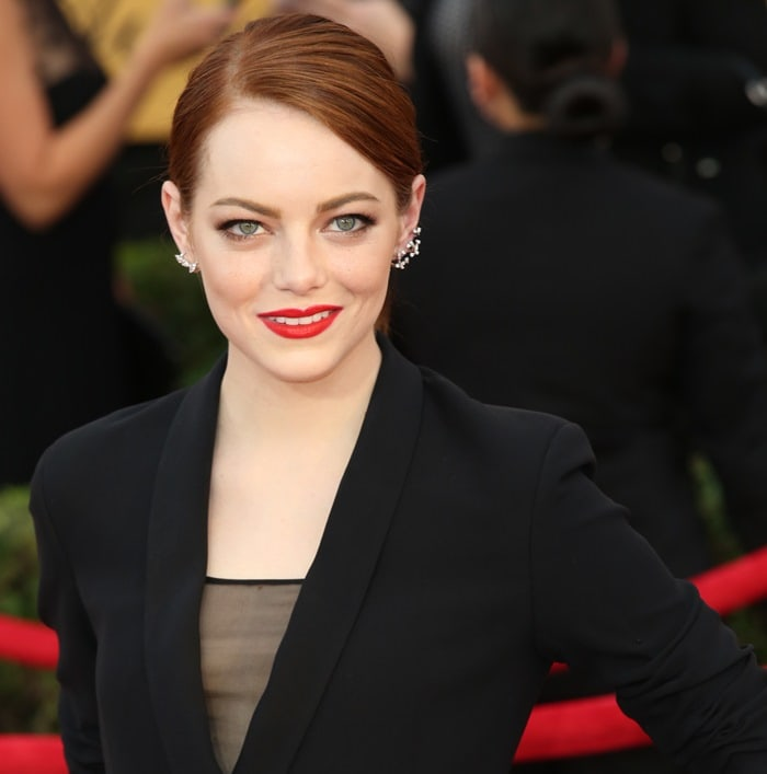 Emma Stone's tuxedo gown featuring sheer black paneling