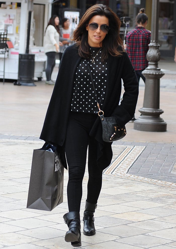 Eva Longoria shows how to wear black leggings with matching biker boots