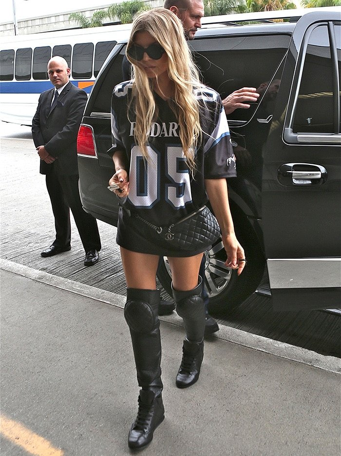 Fergie wearing a jersey dress with black over-the-knee boots
