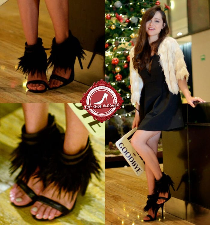 Gaby styles a black dress with fringe sandals
