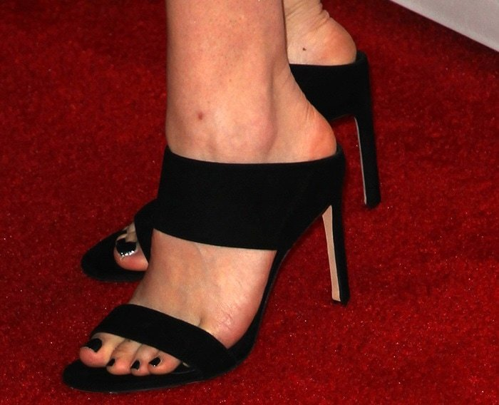 Gillian Jacobs showing off her feet in black strappy sandals