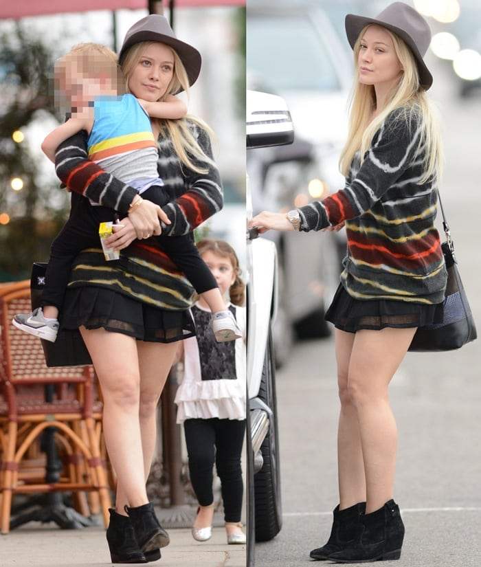 Makeup free Hilary Duff wearing a felt hat and a short black skirt takes son Luca Comrie to Pint Size Kids in Los Angeles on January 28, 2015