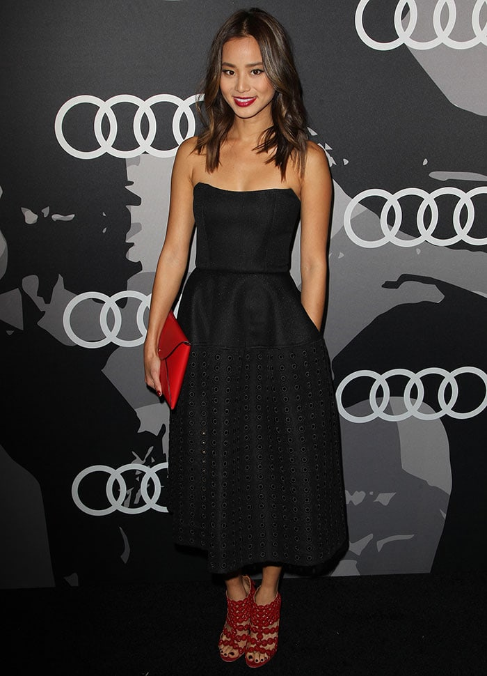 Jamie Chung in a black strapless eyelet dress at Audi's pre–Golden Globe party